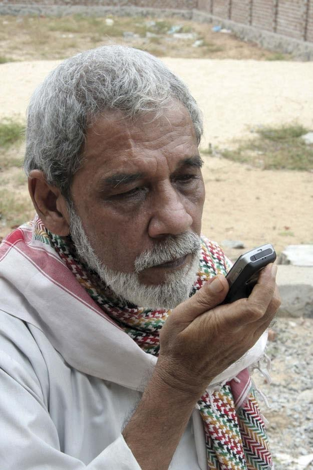 Makkattar using cellphone to transmit curative blessings